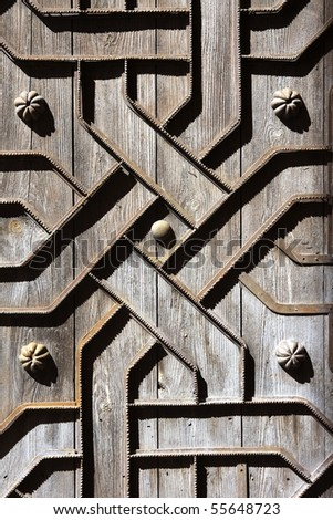 old aged wooden door with iron handcraft deco work spain church