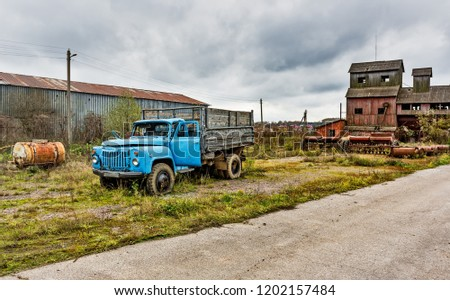 Old agricultural machinery, old truck. .Abandoned collective farm. Russia, Tula region.