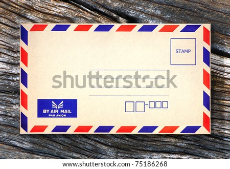 Old air envelope on wooden background