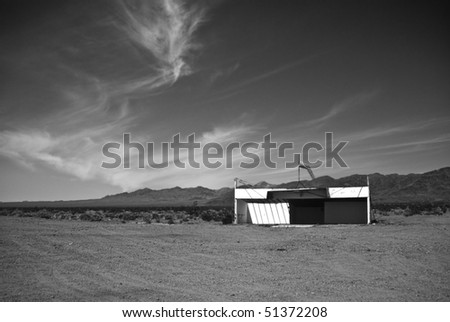 Old airfield at Amboy,California, a modern ghost town in the Mojave Desert on old Route 66 in black and white