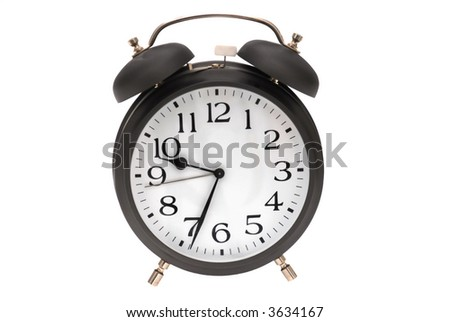 Old alarm clock isolated o the white background