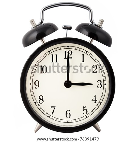 Old Alarm Clock isolated on white in black and white, showing three o'clock. - stock photo