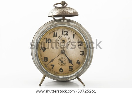 old alarm-clock with bell on white background
