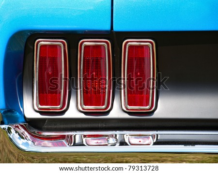 Old American Car/Tail lights of old  Ford Mustang / Oldtimer/ Classic Vintage car/ Automobile/ Stop lights