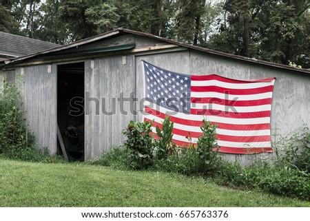 Old American Flag On Very Rustic Barn In Western Virginia 665763376