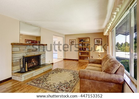 Old American house large living room interior with hardwood floor, rug and fireplace.  #447153352