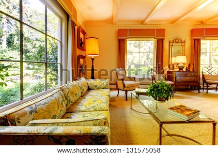 Old American house living room with antique details and large windows.