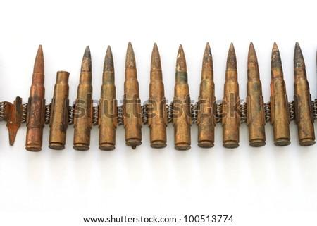 old ammunition WW II belt, isolated on white, detail