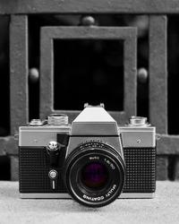 Old analog black and metal camera