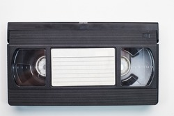 Old analog tape VHS cassette. Retro nostalgia. Vintage gone down in history.
