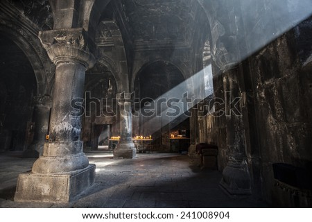 Old ancient Armenian christian church interior with amazing natural light. Geghard Monastery, 12 century