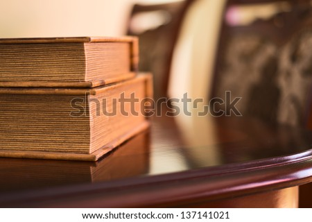 Old ancient book composition over the table as a home interior background