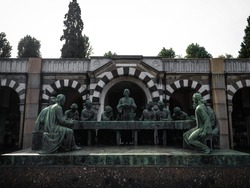 Old ancient historic grave tomb stone sculpture memorial at Cimitero Monumentale graveyard in Milan Lombardy Italy Europe