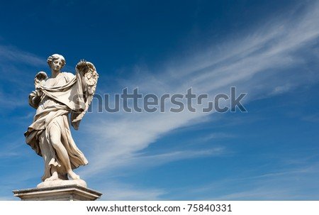 old, ancient sculpture of an angel, Rome, Italy
