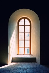 old ancient window with tiled floor photo