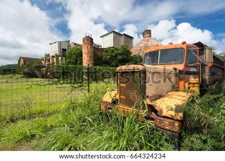 Old and abandoned rusting truck used for sugar cane to Koloa sugar mill on Hawaiian island of Kauai