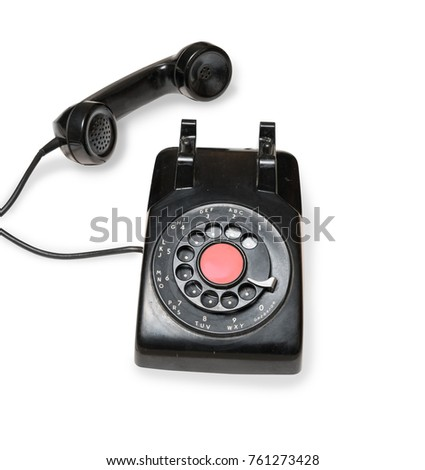 Old and antique rotary telephone isolated against white background #761273428
