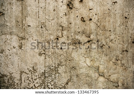 Old and battered stone wall.