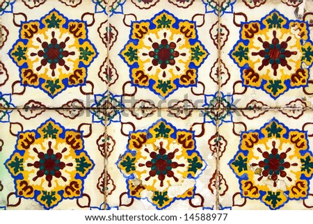 Old  and colored tiles  in a Portuguese wall.
