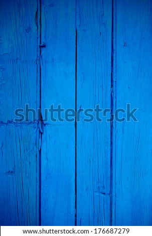 Old and cracked blue painted wooden background