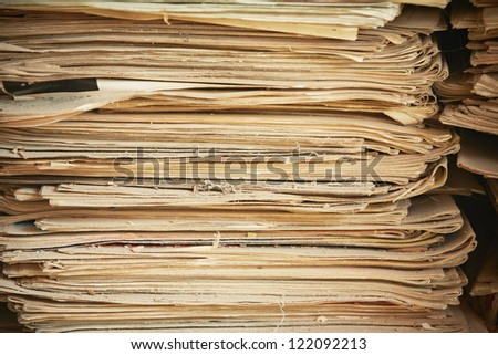 Old and damaged newspapers on heap
