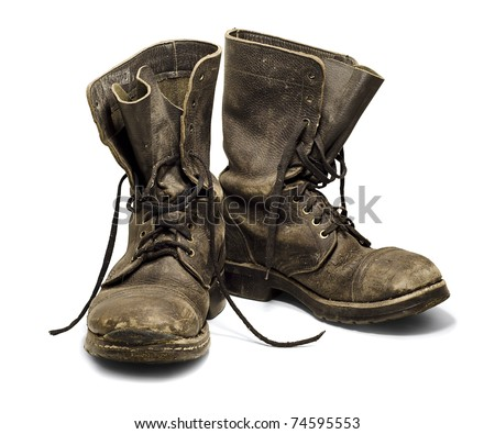 Old and dirty military boots isolated on white background
