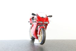 Old and dirty motorcycle plastic model represent the plastic model toy concept related idea.