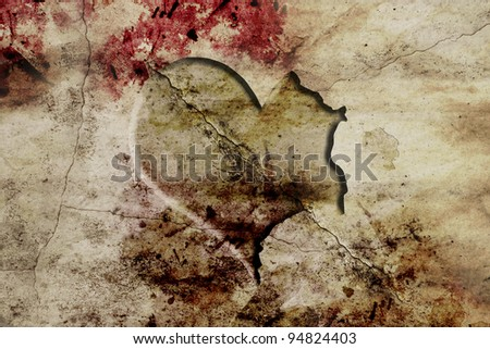 old and fracture wall with carved heart