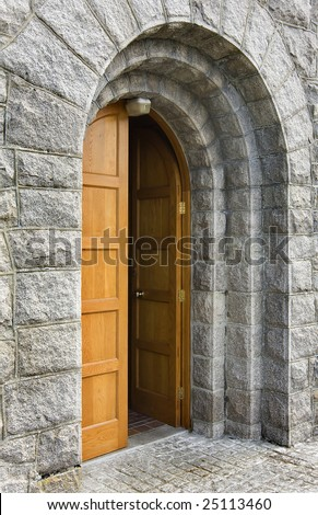 old and heavy church door that is open
