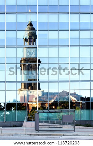 Old and modern Hamburg. St. Michael's Church reflects in modern office building - stock photo