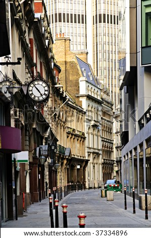 Old and new buildings in city of London - stock photo
