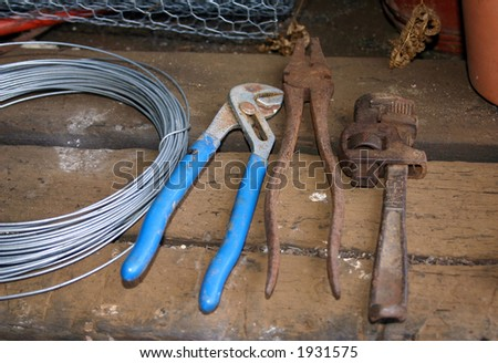 Old and new hand tools on wooden bench