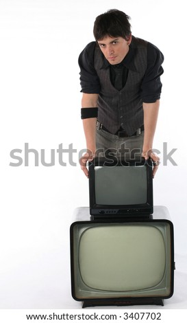 Old and new TV technology concept Young man with retro television set isolated on white