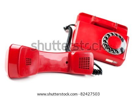 old and red telephone isolated on a white background