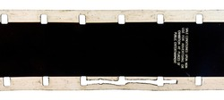 old and retro looking 16mm film strip with wrong and faulty perforation and warning text on white background