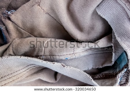 old and ripped apart of old clothes with selective focus