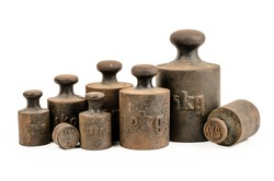 Old and rusty weights on white background