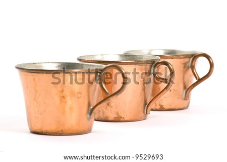Old and scuffed copper cups
