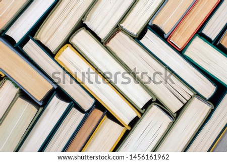 Old and used hardcover books, top view. Educational concept. Close up