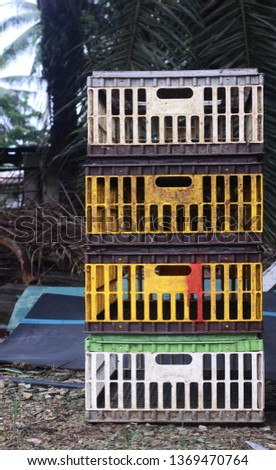 Old and variety color of chicken crates use to supply livestock to market.