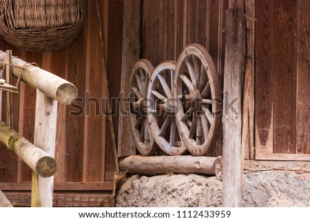 Old and wooden wheels used in the past and used today as decoration #1112433959