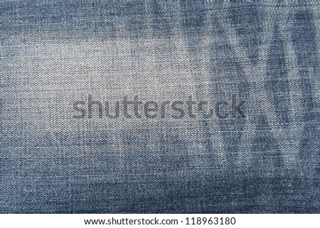 Old and worn blue jeans pattern background in a king size