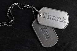 Old and worn military dog tags - Thank You