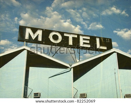 old and worn vintage photo of motel building and sign