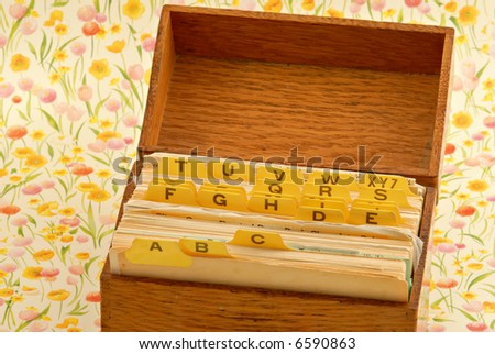 Old and worn wooden recipe box with recipe cards inside.