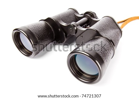 Old antic binocular coated with black leather, isolated on white background