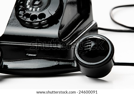 Old antique black isolated phone - stock photo