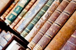 Old antique books background. Antique manuscripts.