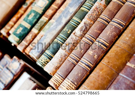 Old antique books background. Antique manuscripts.
