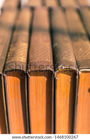 Old antique books background. Antique manuscripts. Antique books with yellow dusty pages.